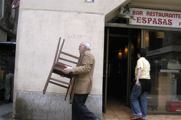 Barcelona. Man moving a chair 2005