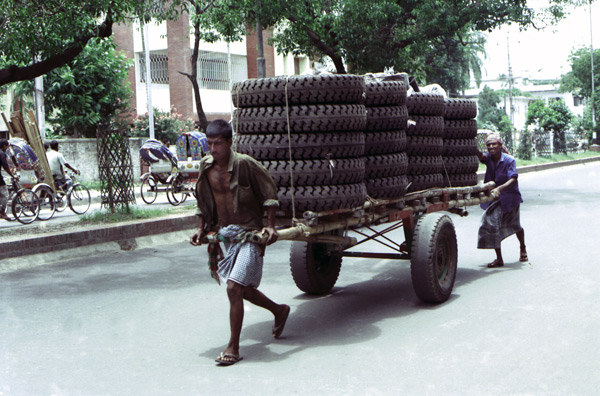 Dhaka pulling tyres on a road