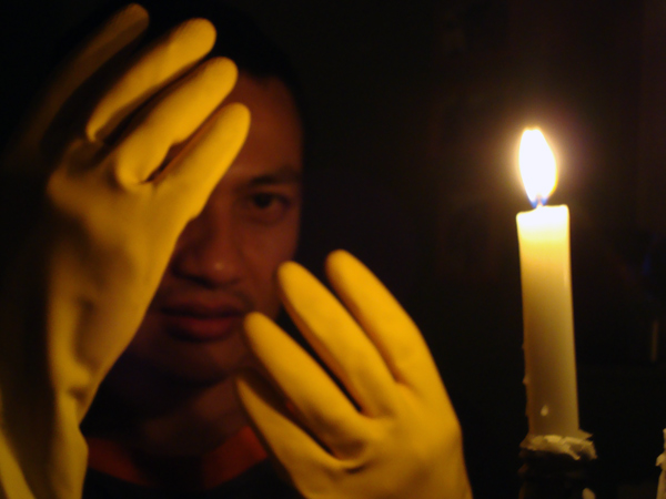 Portrait of Hazuan by candle light, 2010. Taken in our kitchen.