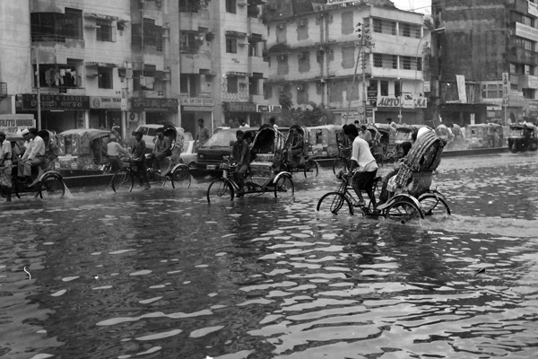 Rickshaws in a flood, Dhaka Bangladesh c. 1992