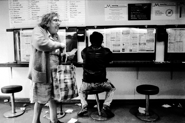 Lady with walking stick in a betting shop, 1990