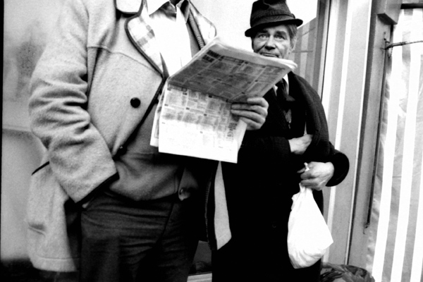 Two men outside a betting shop, Whitechapel 1986