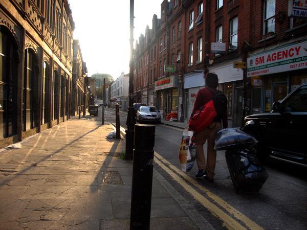 Woman with trolley walking down Fashion Street