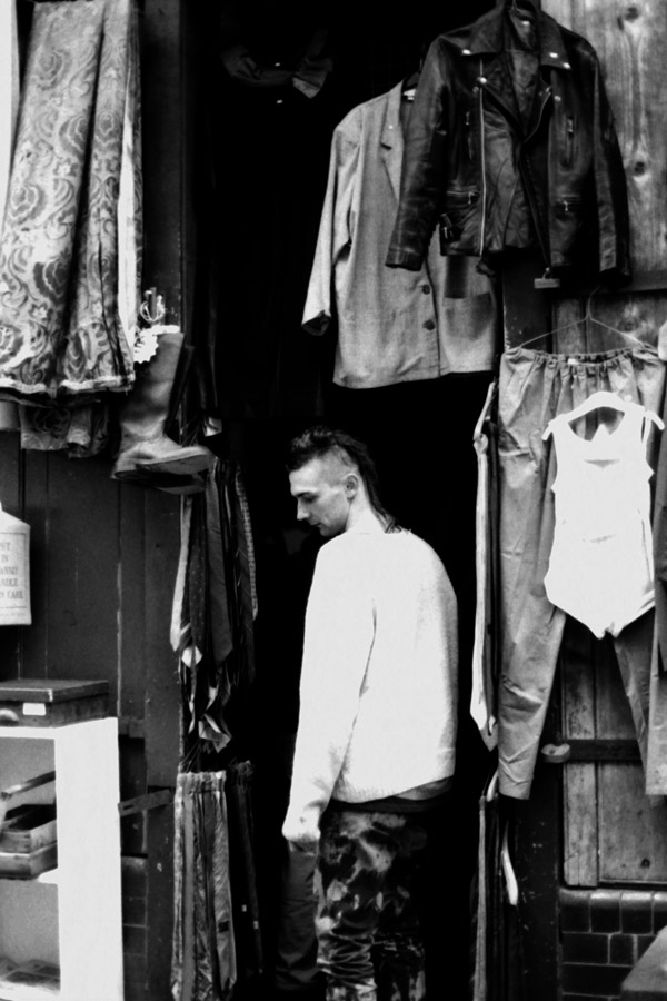 Man shopping for second hand clothes on Cheshire Street