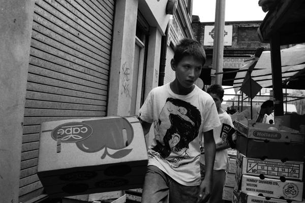 Boy carrying box, Brick Lane 1988