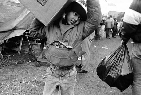Boy carrying box.