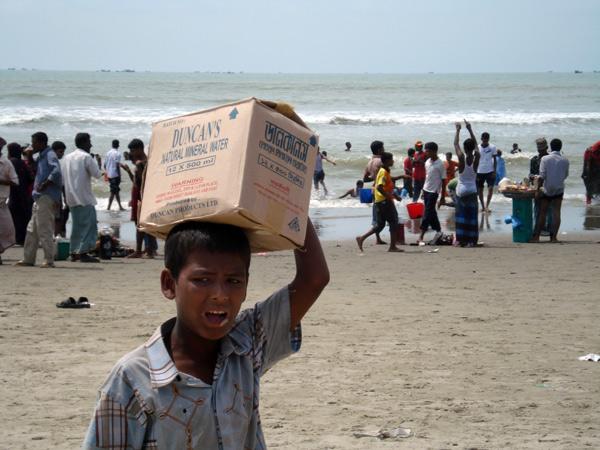 Boy carrying box