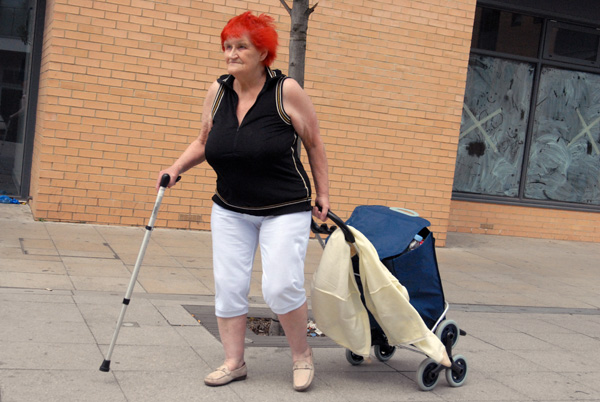 Woman with a walking stick, Watney Market 2008