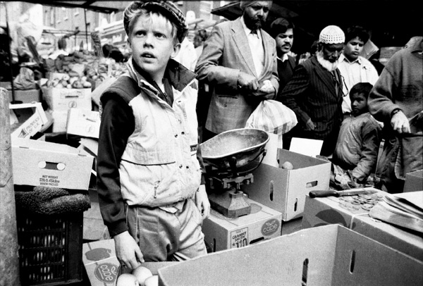 Boy selling vegetables on Brick Lane, 1985