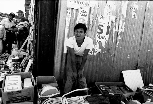 Boy selling junk, Sclater Street 1986