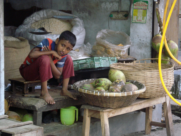 Boy looking after vegetable stall, Chittagong 2008