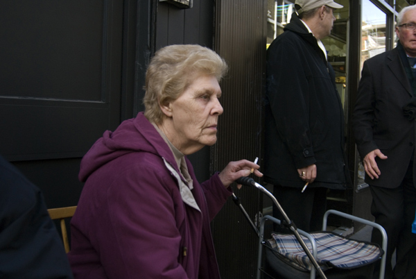 Woman with her thoughts outside the Begal shop in Brick Lane, 2009