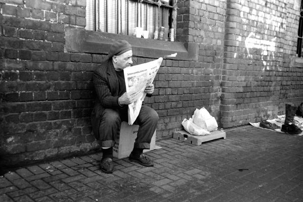 Man reading a paper, Bishopsgate goods yard 1999