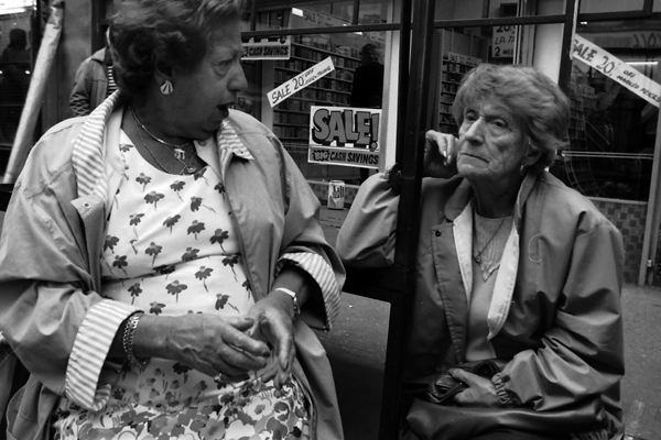 Two ladies having a conversation on a market stall. Middlesex Street 1986