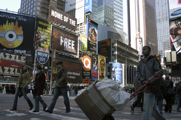 Young man moving goods near Time Square, New York 2005