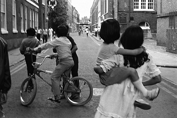 Children with a bike on Brick Lane