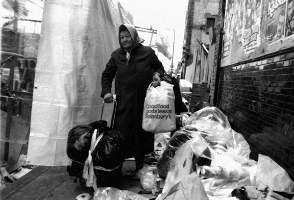 Woman with shopping trolley, Sclater Street 1983