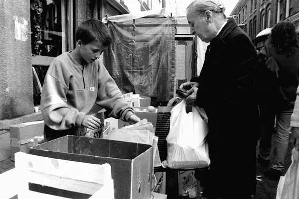 Boy selling fruit, Cheshire Street 1986