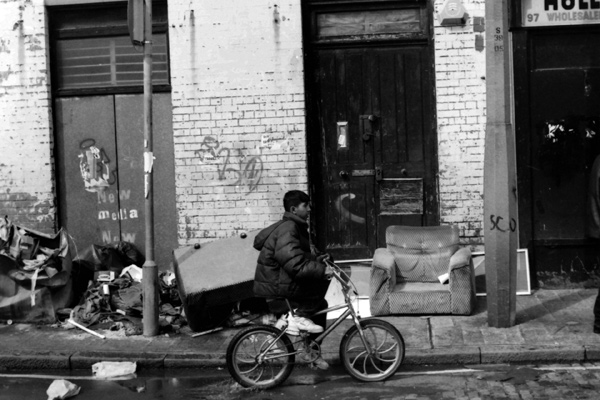 Sclater Street. Boy on bike