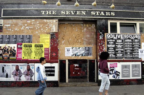 Children walk past the seven stars pub