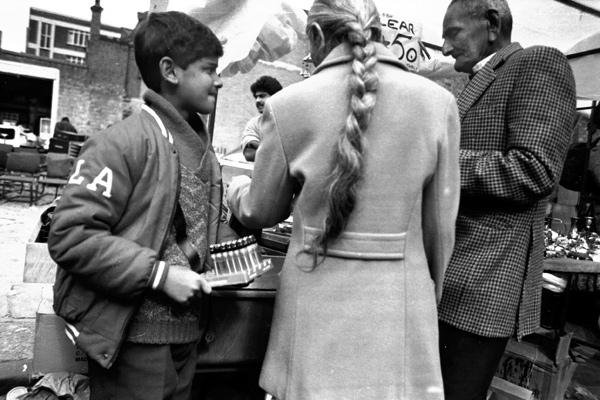 Boy selling lighters, Sclater Street market 1986