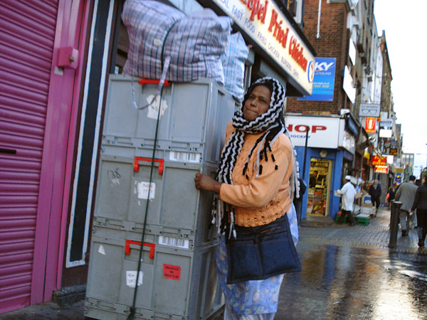 Woman pushing goods on Whitechapel market