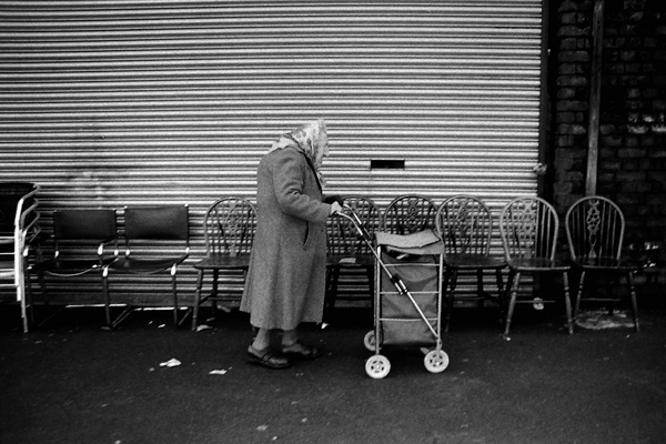 Lady pushing a trolley in Spitalfields, 1999