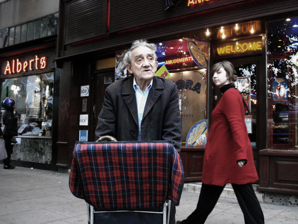 Man with a trolley on Whitechapel Rd, 2010