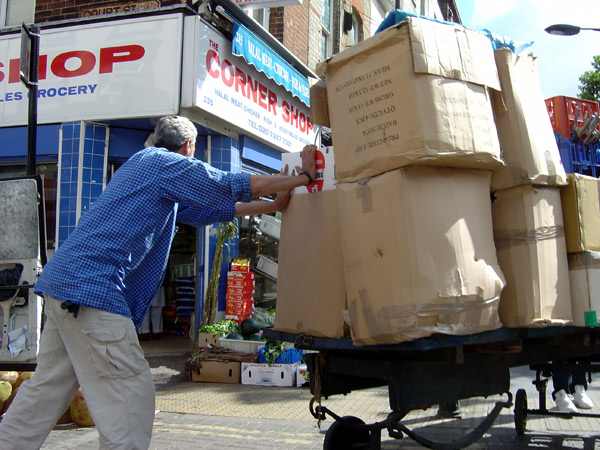 Full cardboard boxes on the move in Whitechapel market, 2007