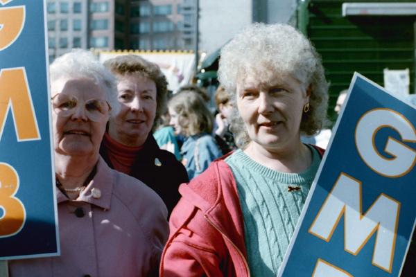 Three women at the TUC anti racist demonstration, 1994