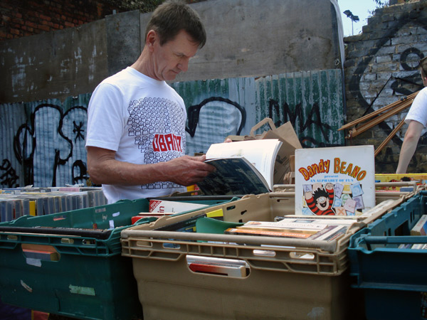 A man looking through second hand books in Sclater Street, 2009