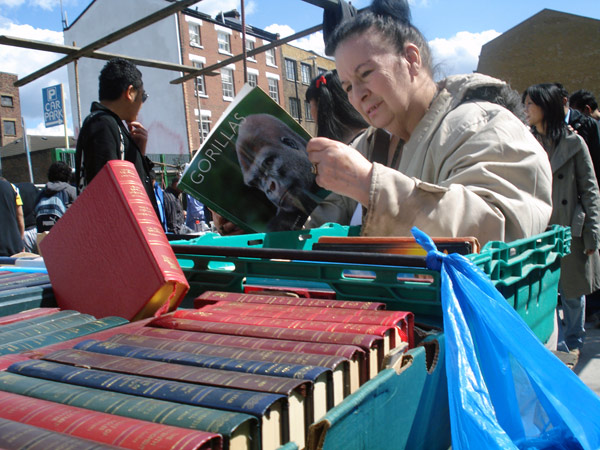 A woman looking through second hand books, Sclater street market 2008