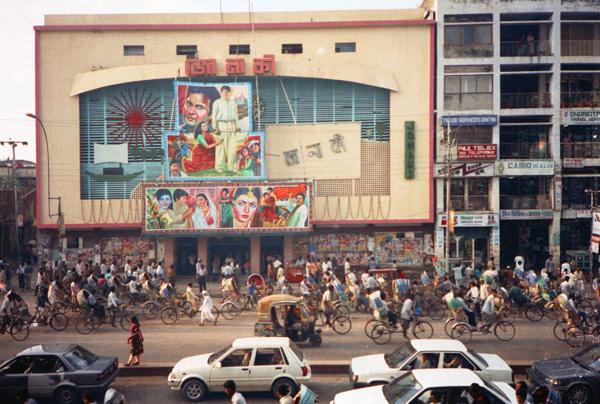 Dhaka cinema with rickshaws waiting outside