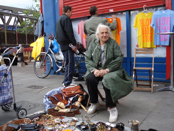 Lady selling second hand goods on Brick Lane