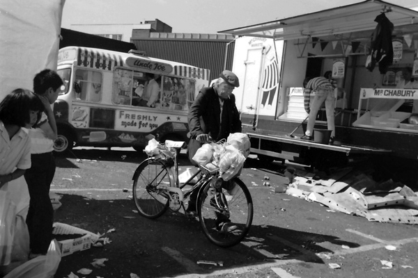 Man with bicycle, Sclater Street market 1986