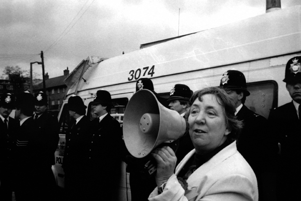 Belle protesting with others outside a BNP election meeting, 1986