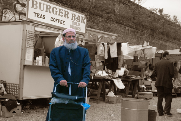 Man with trolley walking away from burger bar