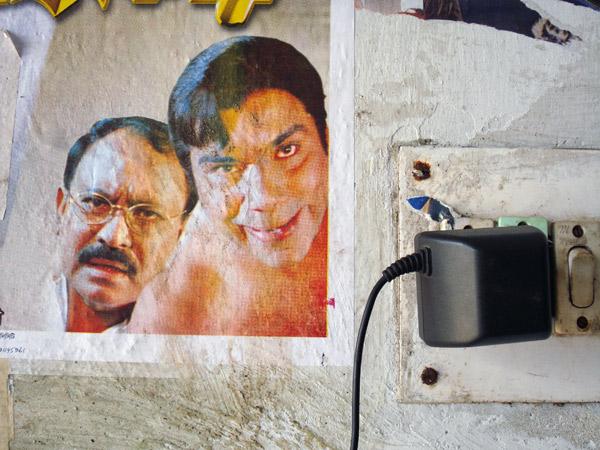 Mobile phone plug and cinema poster remnants