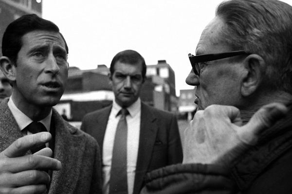 Prince Charles talking to demonstrator against housing privatisation. He was opening housing that had been sold off by the Council. Bethnal Green 1988.