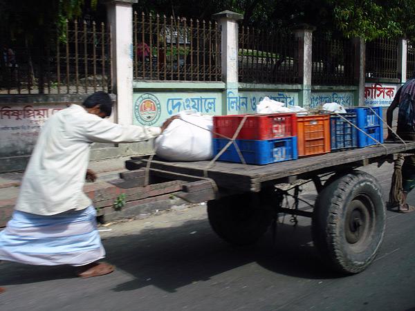 Man pushing a cart. Dhaka, Bangladesh 2009