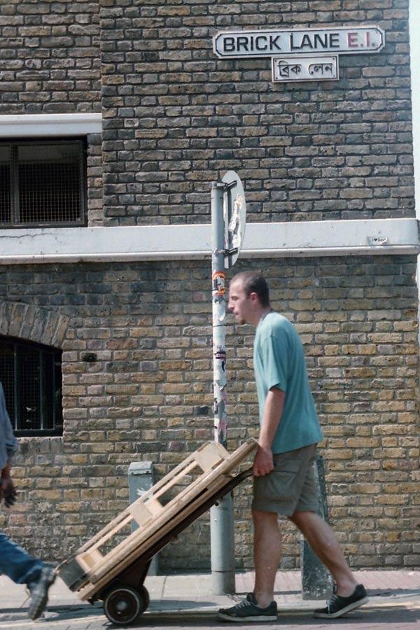 Man pushing trolley on Brick Lane, 2010