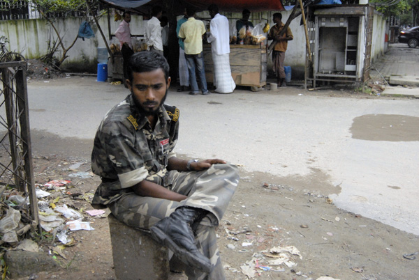 Man resting in the shade, Dhaka Bangladesh 2009