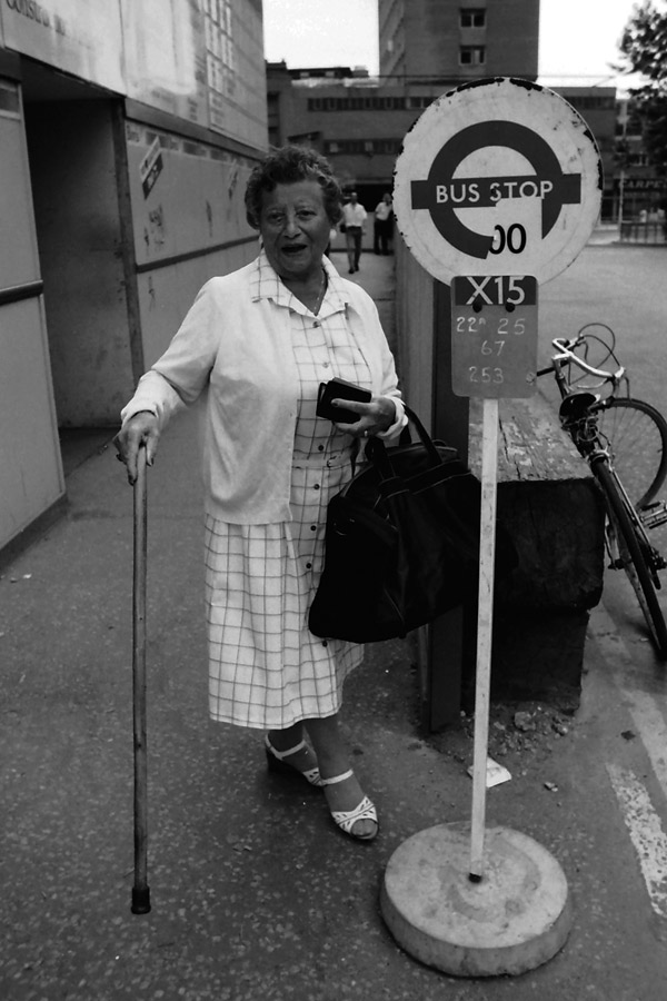 Lady waiting at a temporary bus stop, Aldgate 1988