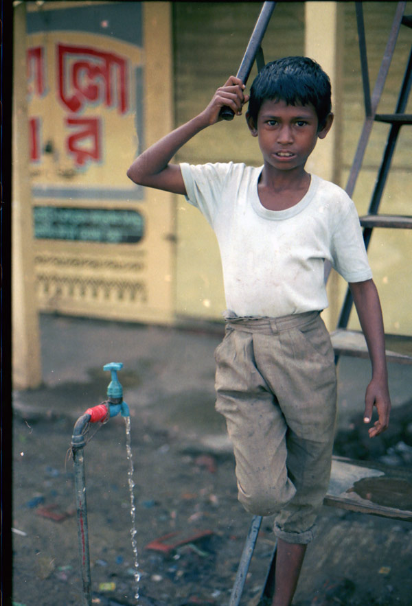 Boy next to a water pipe, Sylhet Bangladesh 1991