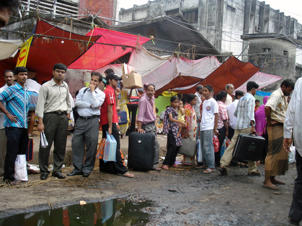 People waiting at a bus stop in Dhaka, Bangladesh 2009