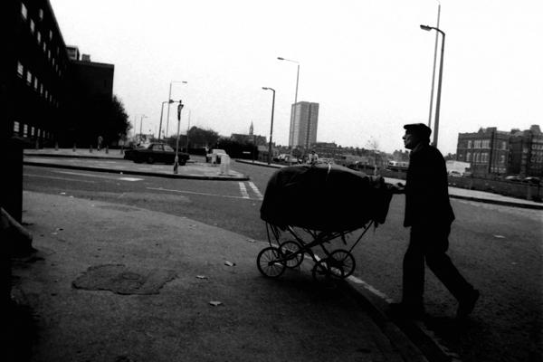 Man pushing pram on Vallance Rd, 1987