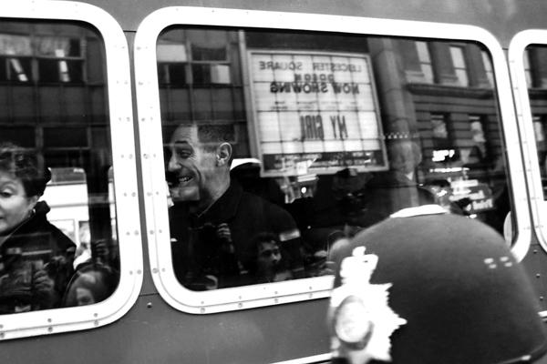 Derek Jarman on a police bus following his arrest 1992