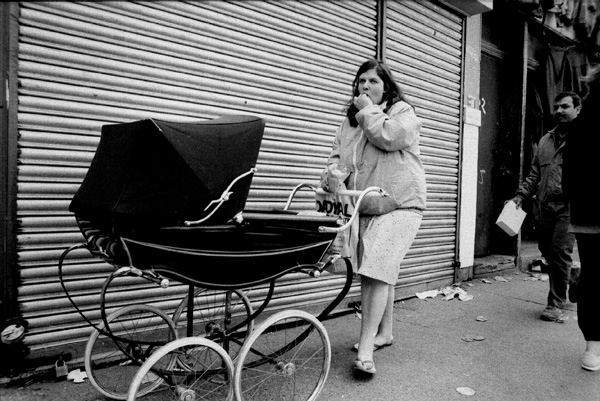Woman with pram on Vallance Road. London 1986
