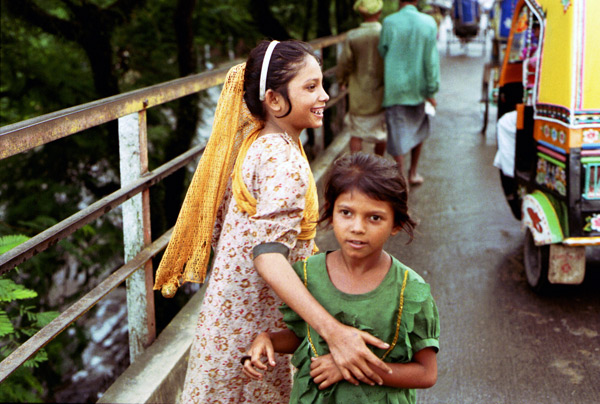 Two girls crossing a bridge in Bangladesh, 1991