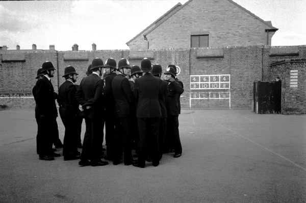 Police attending a BNP meeting in Stepney 1982.
